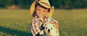Boy with his dog on Farm