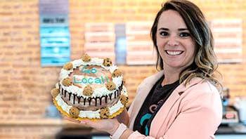 Half Pint Creamery owner Trish Sentz in front of the ice cream case
