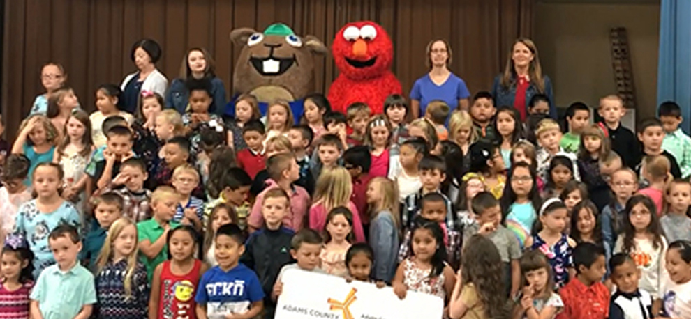 Buckley joins 1st grade students to celebrate launch of the My 1st Card Program