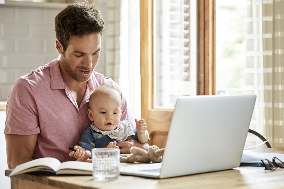Man at computer with son