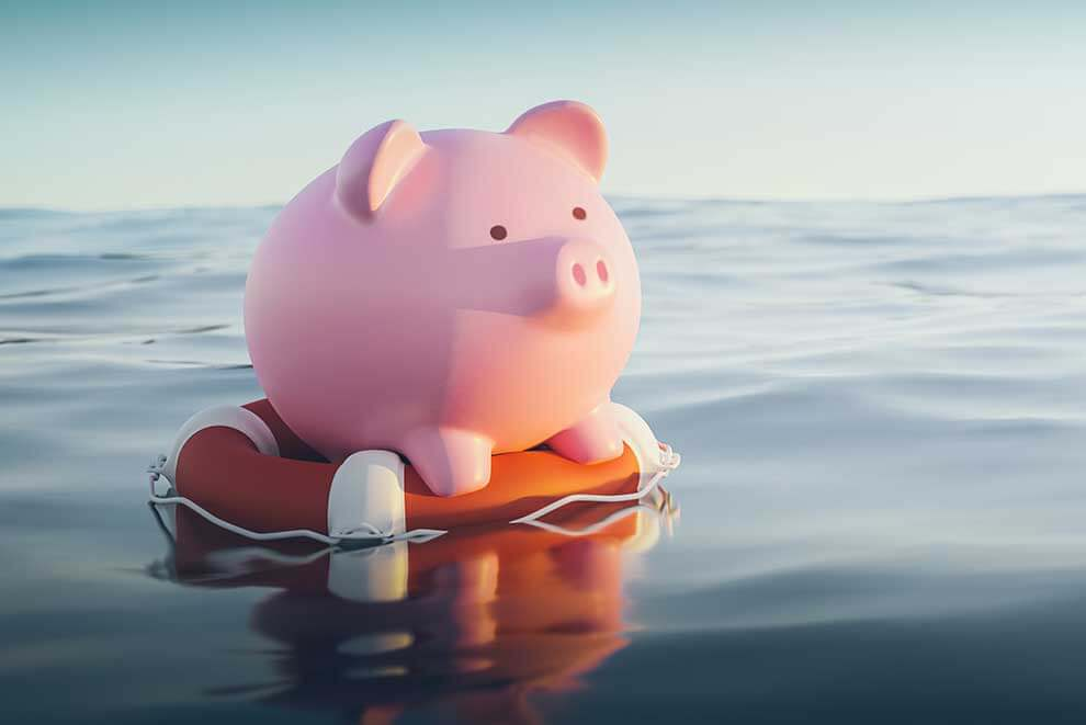 Piggy bank floating on a life preserver