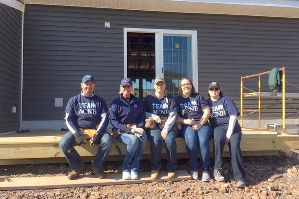 ACNB Bank staff members volunteered their time at a home build in Biglerville, PA, with Habitat for Humanity of Adams County