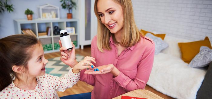 Mom giving child medicine