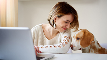Woman with Her Dog Banking Online