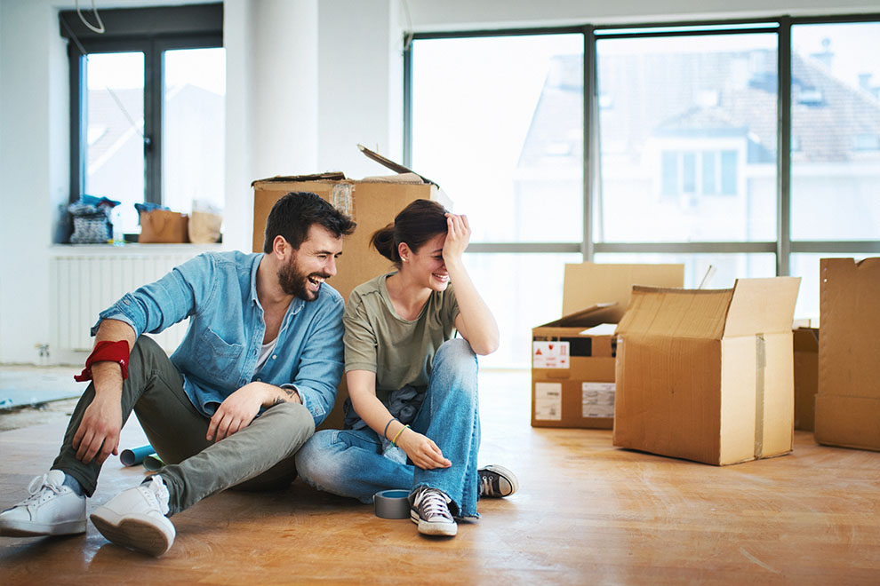 Young couple on floor surrounded by boxes